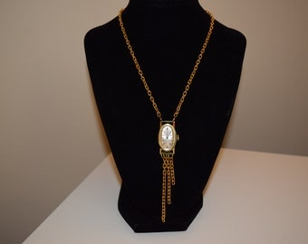 Gold vintage watch face necklace