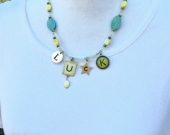 Necklace of Luck! Alphabet charms with pastel beaded accents on stainless steel wire and a toggle clasp. 20 inches long.