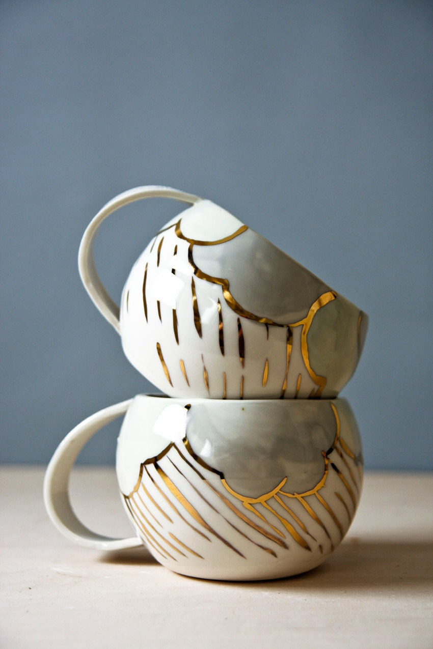porcelain cups. white pastel and gold ceramic cups. large