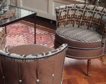 Sophisticated Mid-Century Barrel Chairs on casters