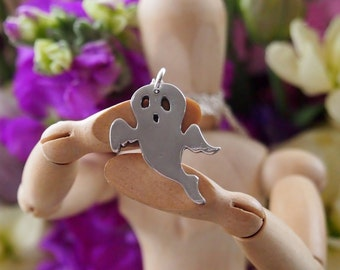 A cute little ghost pendant handmade in fine silver.......