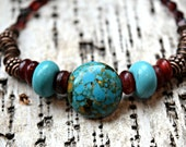 Beautiful turquoise and red colored beads come together to make a brillant boho beaded bracelet by Warped Wire Studio, made in the USA