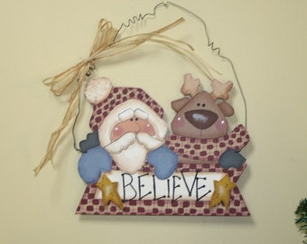 """Christmas in July Santa and Reindeer Wooden Sign Hand Painted that Reads """"Believe"""""""