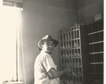 "Vintage Snapshot ""Pigeonholed"" Man Wearing a Fedora Sorting Mail - Found Vernacular Photo - Work - Occupation - Black & White Photograph"