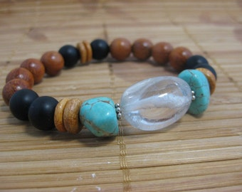 Optical quartz bracelet with Kingman turquoise, matte black onyx gemstone beads, polished Robles wood beads, wood discs and sterling spacers