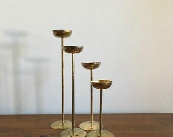 mid century modernist tea light votive candlestick holders. graduating brass hollywood regency candlestick holders. boho candlestick holder
