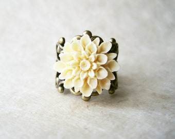 Ivory Dahlia Flower Ring. Adjustable Bronze Filigree Ring with Cream Resin Flower in a Matte Finish. Sweet Bridal Floral Jewellery.