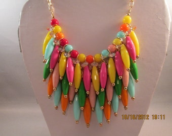4 Row Layered Bib Necklace with Multi Color Beads on a Gold Tone Chain
