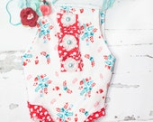 Cheerily - newborn romper in white with aqua, teal, pink and red flowers with red and white polka dot ruffles with coordinating headband