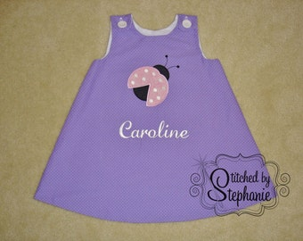 Baby or toddler girls embroidered pink ladybug applique personalized with name monogrammed purple jumper dress