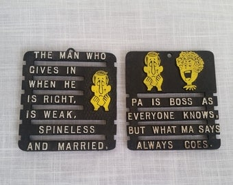 Set of two 50s 60s vintage trivets for the kitschy kitchen black yellow and white