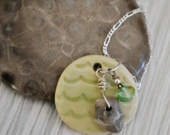 Petoskey stone charm and green crystal on handcrafted ceramic wave pendant,  Michigan necklace, Up North