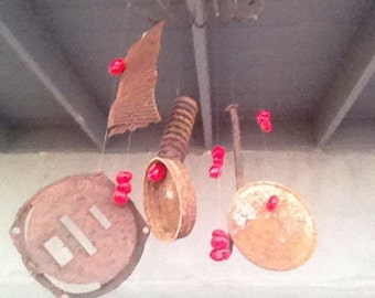 Rustic wind chime made from rusty items found in the desert