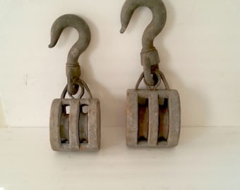 Large Block and Tackle vintage rustic pulleys.  16 inche and 14 inches in height. Priced per pully. Please see all photos