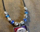 Heart & Wings Necklace with Guitar Pick/Sheet Music Background