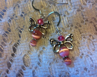 Pink cats eye pierced butterfly earrings.