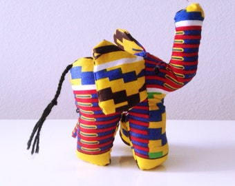 "Small Elephant #01121 made by Ugandan Disabled Women. 4"" height and 5"" wide"
