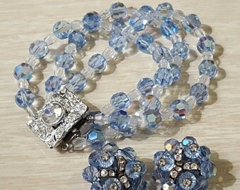 Absolutely lovely, 50's, light blue and clear crystal, 3 strand bracelet and clip earring set with rhinestones!