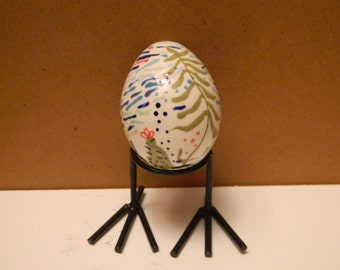 Ceramic egg with esoteric pattern
