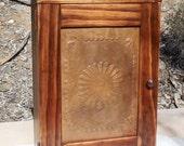 Rustic Pine Wall Cabinet with Stamped Tin Door.  Cove Top, Picture Frame Door.  Optional Over the Door Hangers & Door Decor.