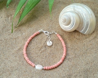 Coral coco bracelet - Coral pink coconut bracelet with bead made out of shell