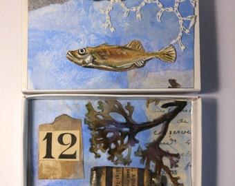 Art box: Shadow box petit diorama réalisé dans une boîte d'allumette.Vison sous marine.Poisson algues et tube de peinture.Assemblage.