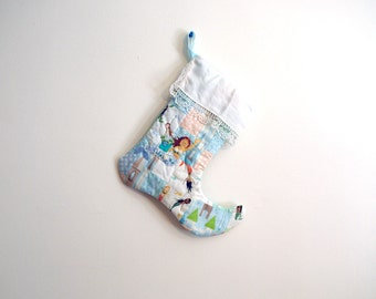 Patchwork Quilted Christmas Stocking in periwinkle, coral, peach, cream, green, blue and brown with Handmade Felt Mermaid Embellishment