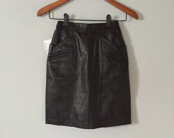 origami pocket skirt | 1980s black leather mini skirt