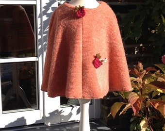 Very cute Kids Poncho for Girls made from knit fabric in Salmon Pink
