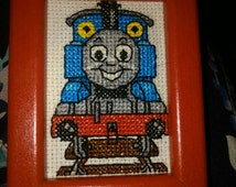 Small Thomas the tank engine cross stitched picture in a wooden frame