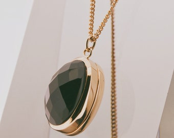 Gold locket with onyx