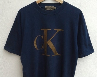 15% ON SALES Vintage 90s CK Calvin Klein sport giant logo gold tee shirt