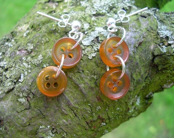 Amber coloured button earrings
