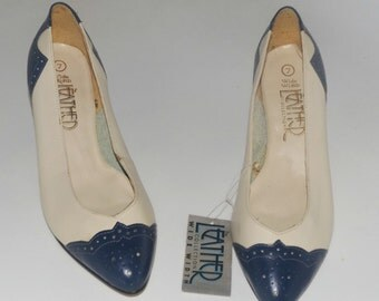 Vintage NWT 1980s spectator pumps in navy and white, women size 7, wide width