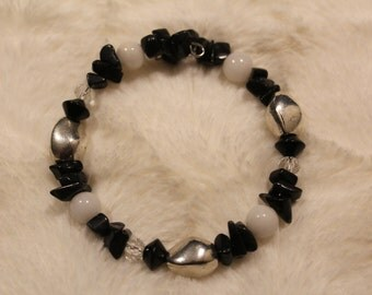 Black and White memory wire bracelets with metal beads.
