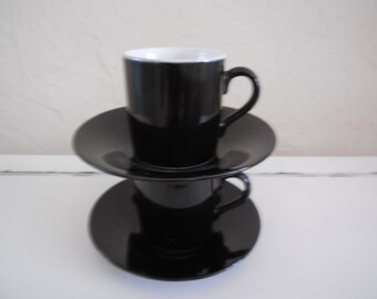 Pair of Black and white espresso cups with saucers