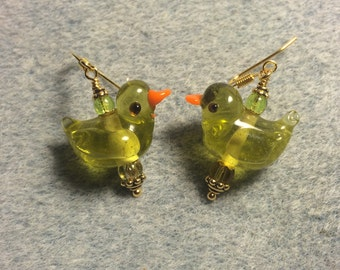 Translucent olive green lampwork duck bead earrings adorned with olive green Czech glass beads.