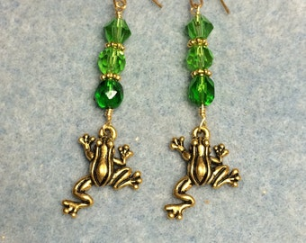 Gold frog charm dangle earrings adorned with green Czech glass beads and Swarovski crystal beads.