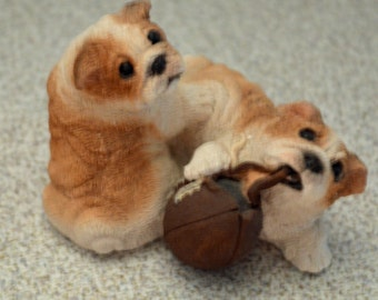 Playful ceramic Bulldog puppy duo
