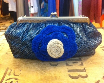 Beautiful evening purse featuring crochet flower detail