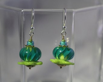 Green and aqua lampwork bead with green flower disc bead