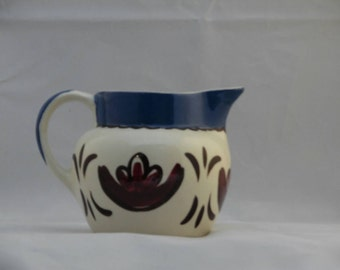 Vintage Pennsylvania Dutch Mon-aire pitcher.