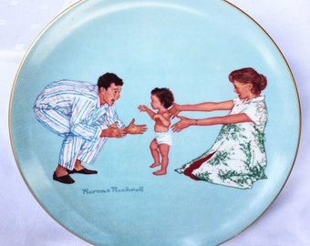 Norman Rockwell Plate, Baby's First Steps from The American Family Series 1977.  Nymber 7364 Limited Edition of 9,900.  8 inches across