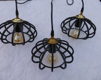 Three sleek black pendant lights hanging ceiling suspended modern