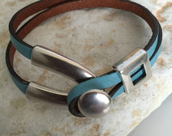 Antique silver finish,   teal leather bracelet