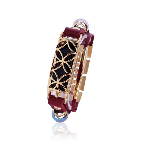 Bracelet Fusion - Flex Jewelry - Red/Gold made from stainless steel and leather