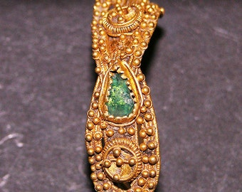Roman (early Christian) 4-5 century A.D., gold earring (37 mm) and with green stone (7 mm). 6.87 gr