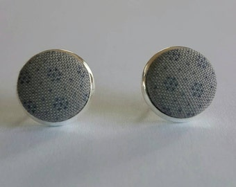 Fabric covered button stud earrings.