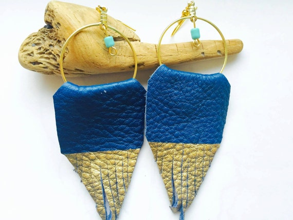 Leather fringe earrings with a bead accent