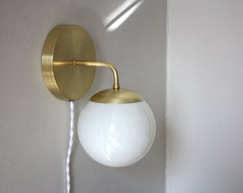 brass globe sconce leo clean modern brass and opal glass wall lamp modern